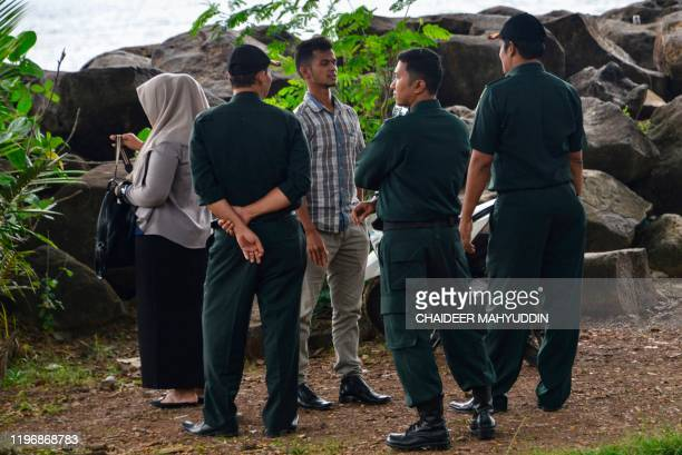 This photo taken on December 11 2019 shows Acehnese Sharia police checking a young couple at a beach in Banda Aceh With more women being charged for...