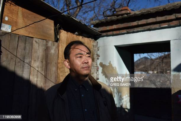 This photo taken on December 11 2019 shows Ma Shihui a coal miner from Sichuan who has been working in the Datai coal mine since 2016 outside his...