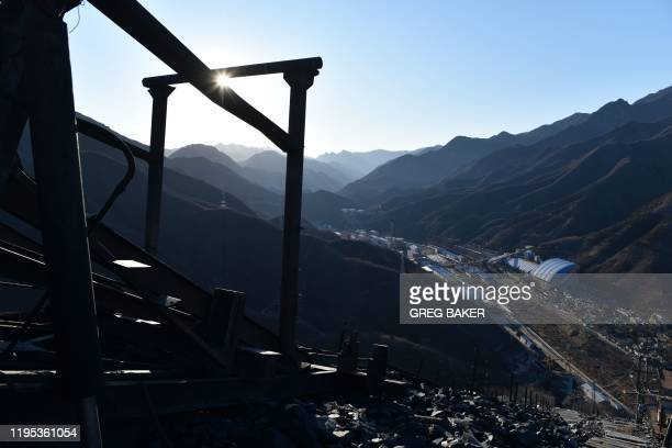 This photo taken on December 11 2019 shows mining equipment on a mountain of rocks above the Datai coal mine in Mentougou west of Beijing