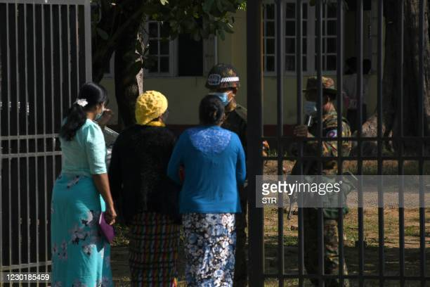 This photo taken on December 11, 2020 shows members of the Arakan Women Network speaking to soldiers outside a military court in Sittwe. - After a...