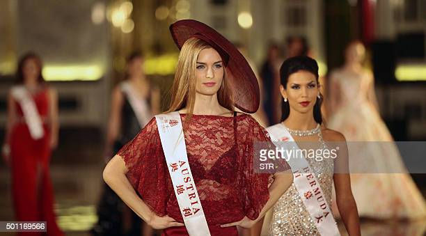 This photo taken on December 12 2015 shows Miss Austria Annika Grill and Miss Bermuda Alyssa MaryVivian Rose attending an event before the Miss World...