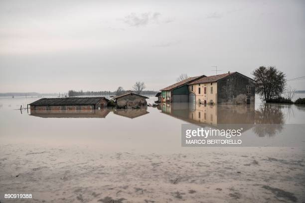 This photo taken on December 12 2017 in Brescello shows a flooded area after the Enza river broke its banks following heavy rain throughout the...