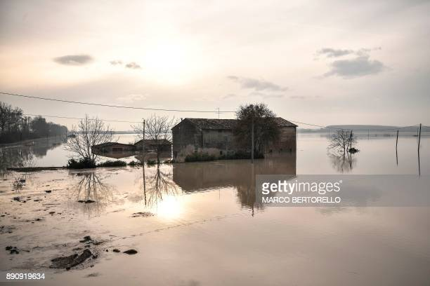 TOPSHOT This photo taken on December 12 2017 in Brescello shows a flooded area after the Enza river broke its banks following heavy rain throughout...