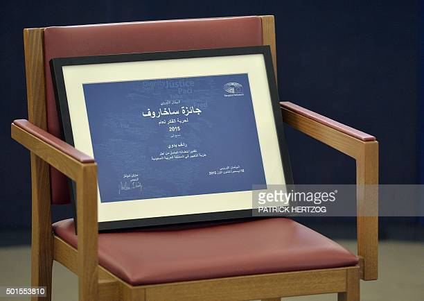 This photo taken on December 16 2015 at the European Parliament in Strasbourg shows a vacant chair with the 2015 Sakharov human rights prize given to...