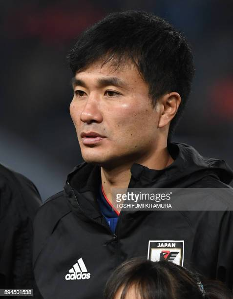 This photo taken on December 16 2017 shows Japan's midfielder Yasuyuki Konno standing prior to the men's football match between Japan and South Korea...