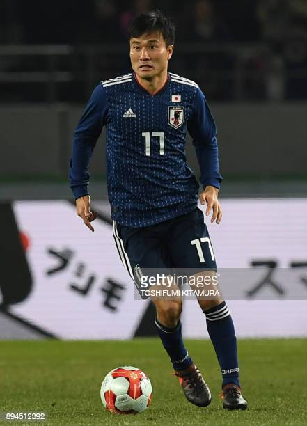 This photo taken on December 16 2017 shows Japan's midfielder Yasuyuki Konno with the ball during the men's football match between Japan and South...