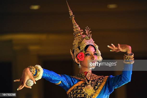 This photo taken on December 17 2012 shows a Cambodian Apsara dancer performing during a ceremony at a hotel in Phnom Penh Wrists bent and fingers...