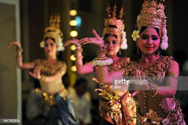 This photo taken on December 17 2012 shows Cambodian Apsara dancers performing during a ceremony at a hotel in Phnom Penh Wrists bent and fingers...