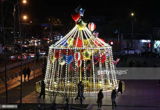 TOPSHOT This photo taken on December 17 2017 shows a Christmas decoration displayed outside a shopping mall in Beijing / AFP PHOTO / / China OUT