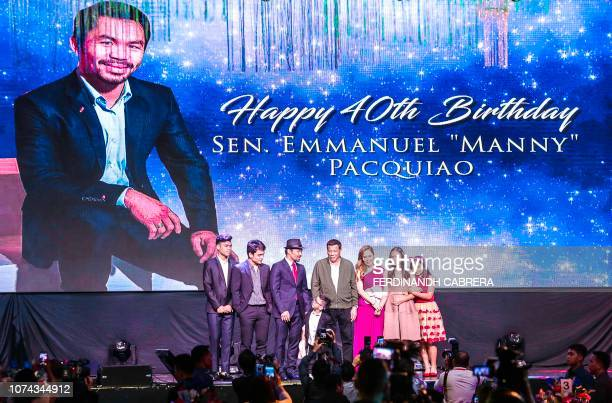 This photo taken on December 17 2018 shows Philippines' President Rodrigo Duterte attending the 40th birthday celebration of boxer Manny Pacquiao in...