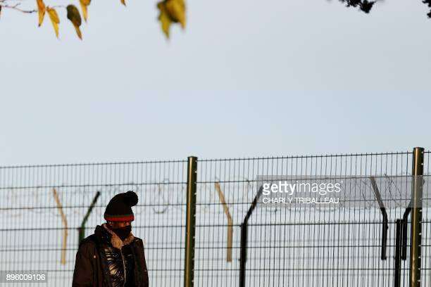 This photo taken on December 18 2017 shows a man walking near the port of Ouistreham near Caen northwestern France One year after the dismantling of...
