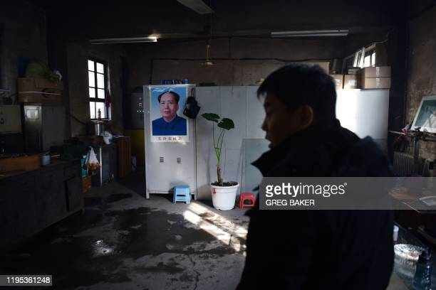 This photo taken on December 18 2019 shows a coal mine worker in a maintenance office at the closed Muchengjian coal mine in Mentougou west of Beijing