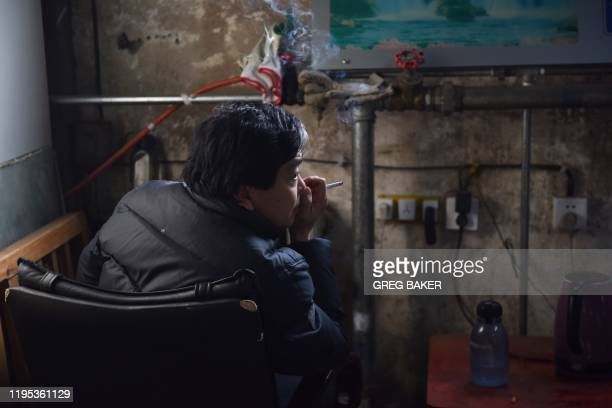This photo taken on December 18 2019 shows a coal mine worker resting in a maintenance office at the closed Muchengjian coal mine in Mentougou west...
