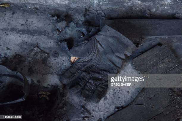 This photo taken on December 18 2019 shows a glove in a deserted building at the Datai coal mine in Mentougou west of Beijing