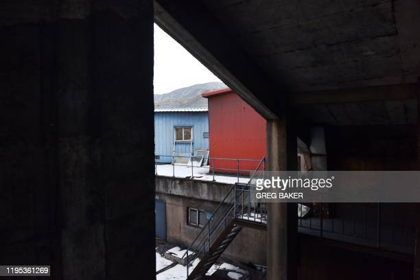 This photo taken on December 18 2019 shows deserted buildings at the Datai coal mine in Mentougou west of Beijing