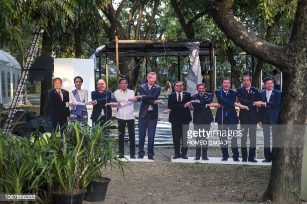 This photo taken on December 2, 2018 shows life-size portraits of the 10 leaders of the Association of Southeast Asian Nations , , Malaysia's Prime...