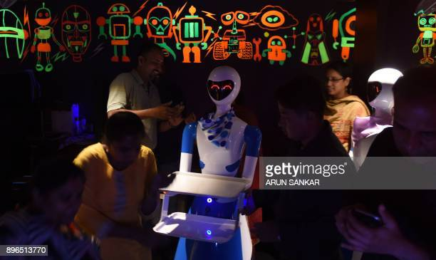 This photo taken on December 20 2017 shows a robot waiter serving Indian customers at a robotthemed restaurant in Chennai India's first robotthemed...