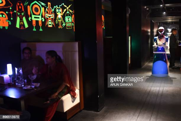 TOPSHOT This photo taken on December 20 2017 shows a robot waiter serving Indian customers at a robotthemed restaurant in Chennai India's first...