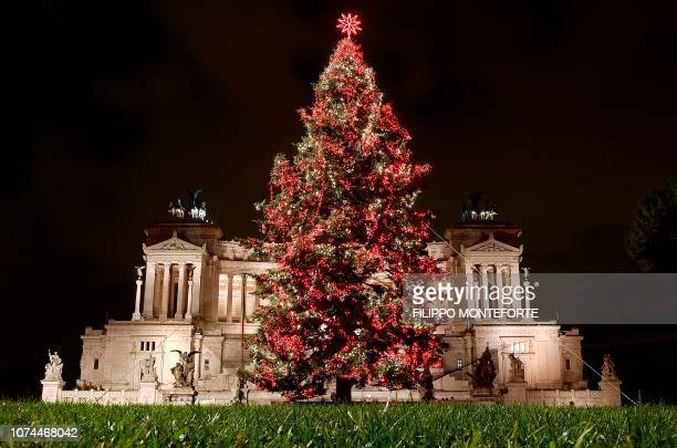 This photo taken on December 20, 2018 shows an illuminated christmas tree in central Rome's Piazza Venezia.