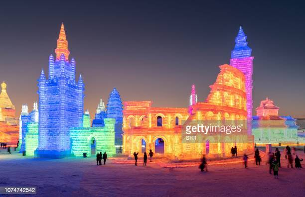 This photo taken on December 23 2018 shows people visiting the Harbin IceSnow World in Harbin China's northeastern Heilongjiang province The Harbin...