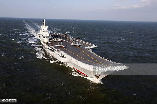 This photo taken on December 24 2016 shows the Liaoning China's only aircraft carrier sailing during military drills in the Pacific Taiwan's defence...