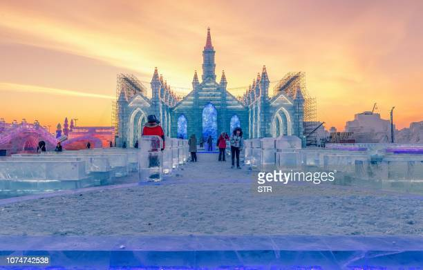 This photo taken on December 24 2018 shows people visiting the Harbin IceSnow World in Harbin China's northeastern Heilongjiang province The Harbin...