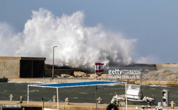 This photo taken on December 24 2019 shows waves crashing by the fishermen's port in the coastal northern Lebanese town of Batroun as wind exceeds a...