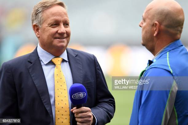 This photo taken on December 27 2016 shows former Australian cricket player and now Channel Nine cricket commentator Ian Healy interviewing...