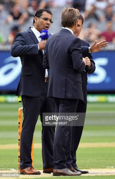 This photo taken on December 27 shows former Pakistan fast bowler and Channel Nine cricket commentator Waqar Younis with fellow commentators Mark...