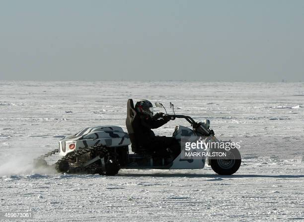 This photo taken on December 28 2013 shows a man riding his ice bike during a festival where members of the Chinese Mongolian ethnic group catch fish...