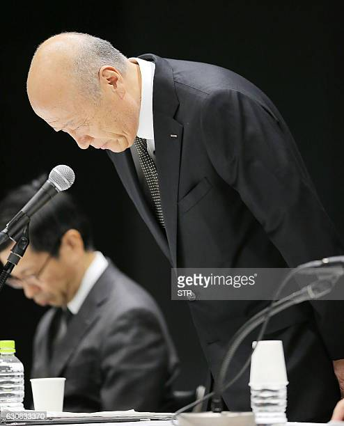 This photo taken on December 28 2016 shows Tadashi Ishii president of Japan's biggest advertising agency Dentsu bowing during a press conference in...