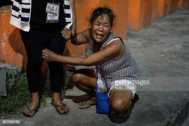 This photo taken on December 29 shows Maria Espinosa crying outside the funeral parlor where the body of her dead 16 year old son Sonny Espinosa was...