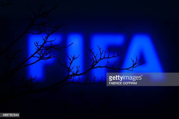 This photo taken on December 3 2015 in Zurich shows a sign outside of the FIFA headquarters The unprecedented corruption scandal engulfing FIFA...