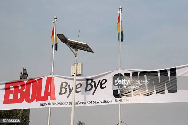 This photo taken on December 30 2015 in Conakry shows a banner for the Bye bye Au revoir Ebola memorial concert International artists Youssou Ndour...