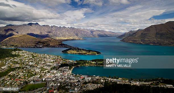 This photo taken on December 31 2013 shows the city of Queenstown on the shores of Lake Wakatipu with the Remarkables mountain range in the...