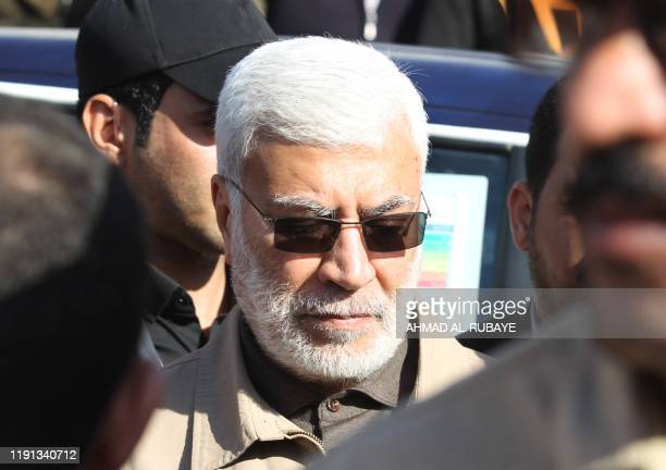 This photo taken on December 31 2019 shows Abu Mahdi alMuhandis a commander in the Popular Mobilization Forces attending the funeral procession of...