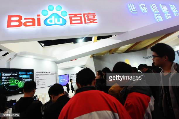 This photo taken on December 4, 2017 shows people visiting the Baidu booth during the 4th World Internet Conference in Wuzhen in China's eastern...