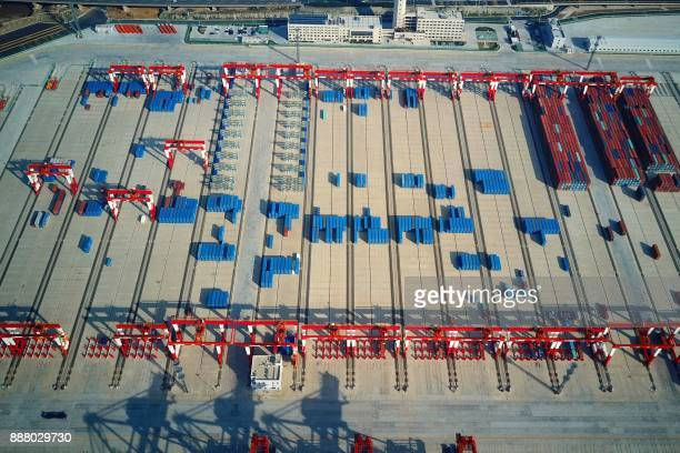 This photo taken on December 6 2017 shows a general view of the Yangshan DeepWater Port an automated cargo wharf in Shanghai Chinese exports surged...
