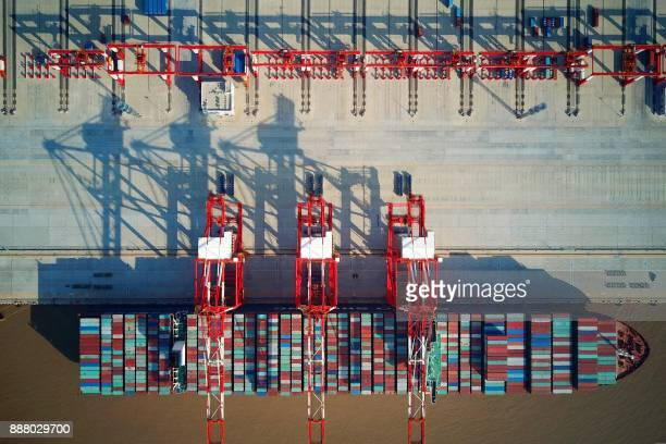 This photo taken on December 6 2017 shows a loaded cargo ship at the Yangshan DeepWater Port an automated cargo wharf in Shanghai Chinese exports...