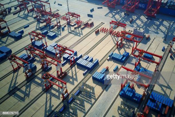 This photo taken on December 6 2017 shows an aerial view of the Yangshan DeepWater Port an automated cargo wharf in Shanghai Chinese exports surged...