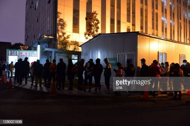 This photo taken on December 8, 2020 shows residents queuing up to take nucleic acid tests for the Covid-19 coronavirus in Chengdu, in western...