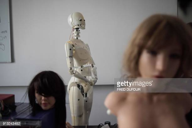 TOPSHOT This photo taken on February 1 2018 shows robots in a lab of a doll factory of EXDOLL a firm based in the northeastern Chinese port city of...