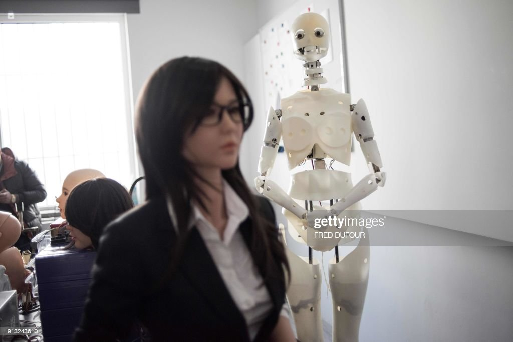 This photo taken on February 1, 2018 shows robots in a lab of a doll factory of EXDOLL, a firm based in the northeastern Chinese port city of Dalian. With China facing a massive gender gap and a greying population, a company wants to hook up lonely men and retirees with a new kind of companion: 'Smart' sex dolls that can talk, play music and turn on dishwashers. / AFP PHOTO / FRED DUFOUR / TO GO WITH China-sex-lifestyle, FOCUS by Joanna CHIU