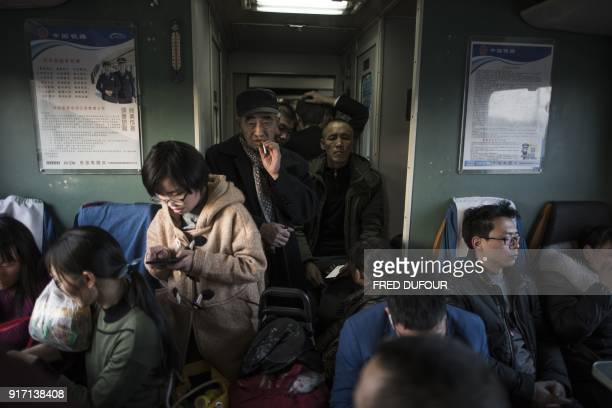 TOPSHOT This photo taken on February 10 2018 shows passengers on a crowded train as it leaves the West Railway Station in Beijing for the 26hour...