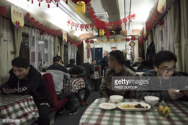 This photo taken on February 10 2018 shows passengers sitting in the restaurant car during the 26hour train journey from Beijing to Chengdu in...