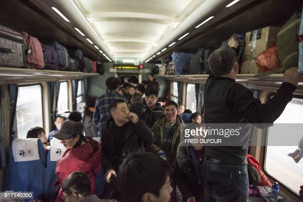 This photo taken on February 10 2018 shows passengers staking thei claim to available space on a crowded train as it leaves the West Railway Station...