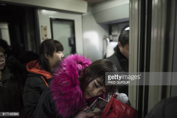 This photo taken on February 10 2018 shows passengers standing on a crowded train for the 26hour journey from Beijing to Chengdu that leaves from...