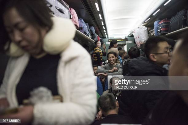 This photo taken on February 10 2018 shows passengers travelling on a crowded car during the 26hour train journey from Beijing to Chengdu in...