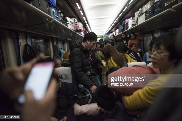 This photo taken on February 10 2018 shows passengers travelling on a crowded train during the 26hour journey from Beijing to Chengdu in Shijiazhuang...