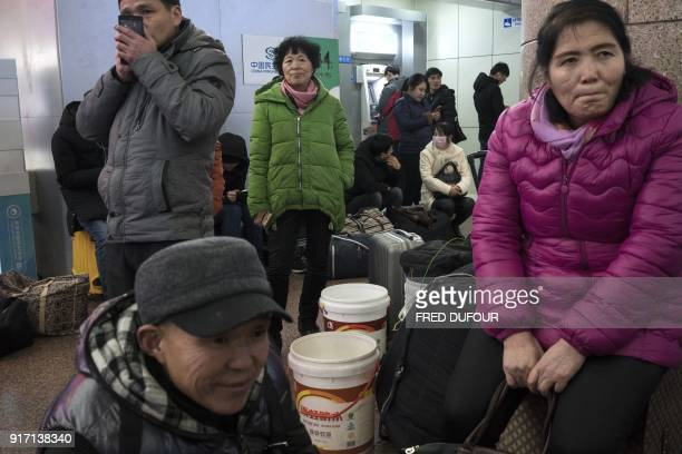 This photo taken on February 10 2018 shows people waiting for train tickets at the West Railway Station in Beijing as travellers depart the capital...